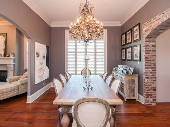 The dining room has a light and airy decor.