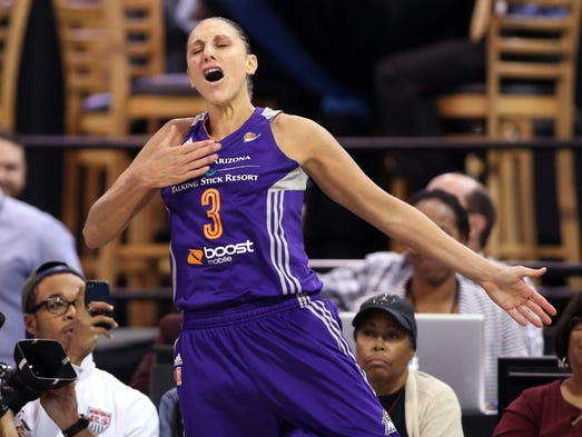 Phoenix Mercury guard Diana Taurasi (3) celebrates after making a basket while being fouled by the Chicago Sky in the fourth quarter in Game 3 of the 2014 WNBA Finals at UIC Pavilion.