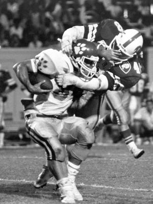 Duke linebacker Mike Junkin, a 1983 Belvidere graduate, tackles a Clemson player. Junkin's 513 tackles at Duke are an area NCAA Division I record.