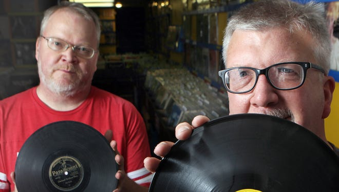 Brothers Darren (left) and Jim Blase, owners of Shake It Records in Northside, with a few of the 20,000 rare records they recently purchased from a Boston collector.  The record Jim (right) is holding, an early Sun record by Jimmy and Walter, is worth $800.