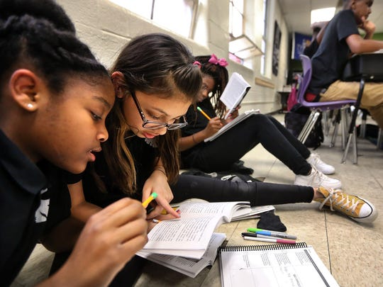 Aspire Coleman seventh-graders Dasia Madison, left,
