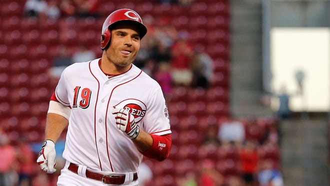 Cincinnati Reds first baseman Joey Votto (19) reacts as he rounds the bases following a two-run home run in the fifth inning during the National League baseball game between the Milwaukee Brewers and the Cincinnati Reds on June 27, 2017 at Great American Ball Park.