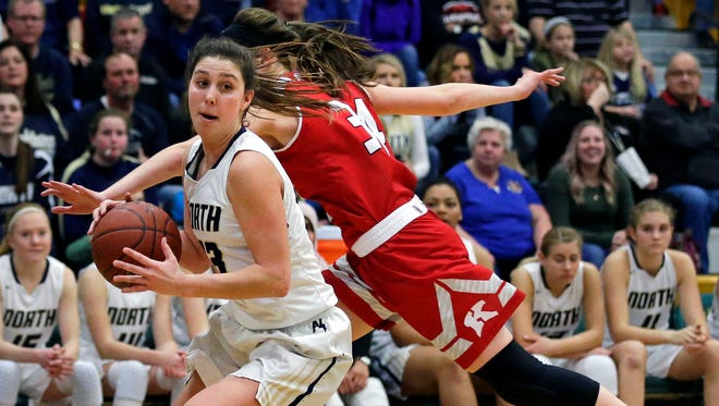Paige Schabo of Appleton North spins away from the defense of Maddy Schreiber of Kimberly in a Division 1 sectional final Saturday in Oshkosh.