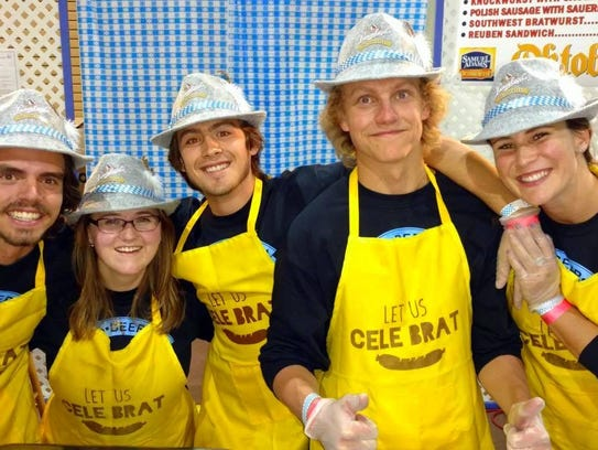 A crew fed bratwursts to hundreds of attendees at last