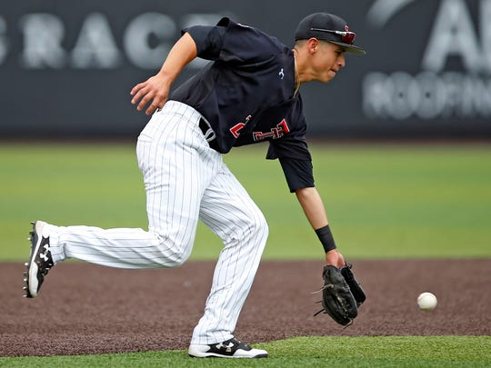 Texas Tech's Orlando Garcia (2) fields a ground ball during an NCAA college baseball regional against Delaware, Friday, June 2, 2017, in Lubbock, Texas.