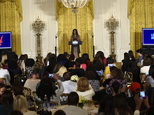 First lady Michelle Obama speaks in the East Room of the White House on Tuesday during an event with parenting bloggers, online influencers and content creators for a conversation about the health of kids as part of her Let's Move! initiative.