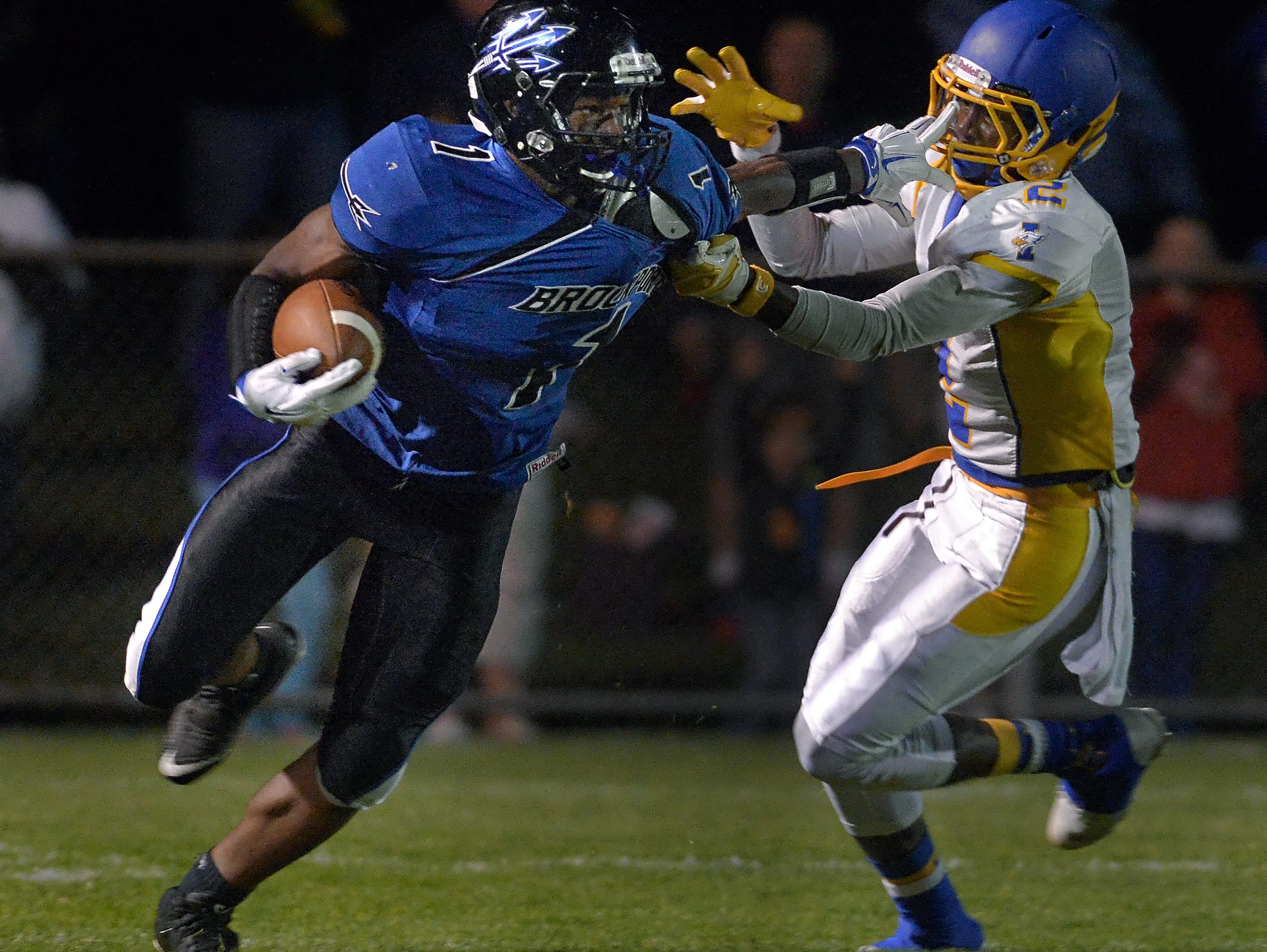 Brockport's Cory Gross, left, turns the corner on Irondequoit's Ty'Sean Sizer during regular season game played at Brockport High School on Friday, September 25, 2015.