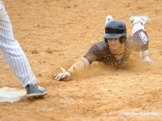 Bishop Eustace's Sky Duff slides head first into third