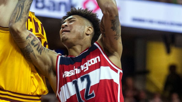 Washington Wizards' Kelly Oubre Jr. (12) is fouled by Cleveland Cavaliers' Kyle Korver during the second half of an NBA basketball game in Cleveland, Saturday, March 25, 2017. The Wizards won the game 127-115. (AP Photo/Phil Long)