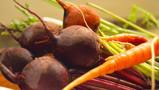 Beets, shown here with carrots, are a tasty root vegetables.