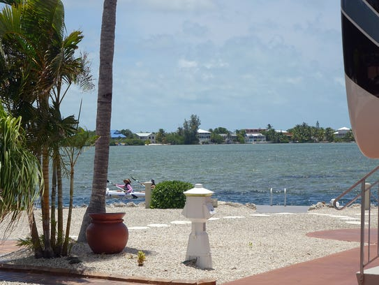 Kayakers paddle past the Bluewater Key RV resort near