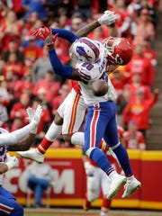 Kansas City Chiefs wide receiver Demarcus Robinson (14) misses a catch while defended by Buffalo Bills cornerback E.J. Gaines (28) during the second half of an NFL football game in Kansas City, Mo., Sunday, Nov. 26, 2017. (AP Photo/Charlie Riedel)