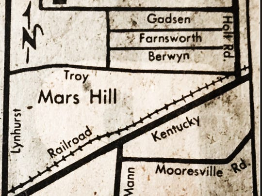 A map shows the layout of the Mars Hill neighborhood from a vintage newspaper at the Central Library.