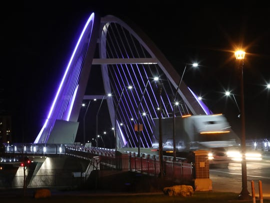 The Lowry Bridge was lit purple to mark the one-year anniversary of Prince's passing on April 20, 2017 in Minneapolis, Minn.