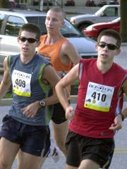 In this YDR file photo from 2007, Kennard-Dale graduates and twin brothers Jon, left, and Matt Grey battle it out for first place at the Bon-Ton 5-mile run, while Ben Massam of Chatam, N.J., trails close behind. Jon Grey outraced his brother to bring home first place, while Massam took second and Matt Grey finished third.