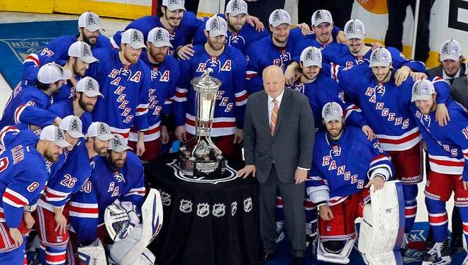 The New York Rangers pose with the Prince of Wales Trophy after beating the Montreal Canadiens 1-0 in Game 6.