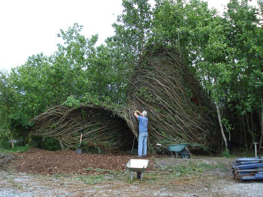 Patrick Dougherty puts finishing touches on one of his installations. His work has appeared around the world. He begins a three week residency at the Blackfoot Pathways: Sculpture in the Wild in Lincoln this month.