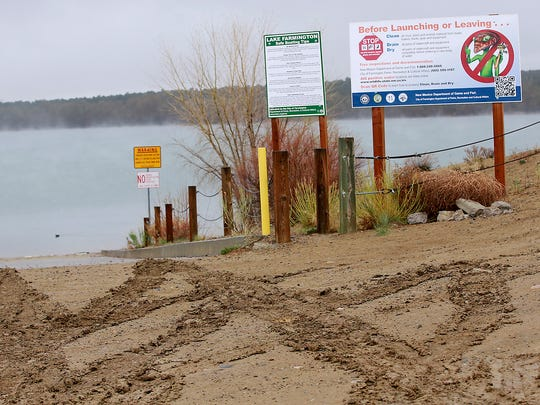 A muddy boat ramp welcomes visitors to opening day for boating on Saturday at Farmington Lake.
