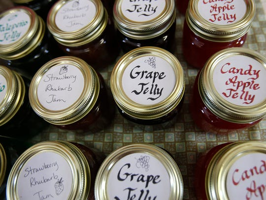 Various jellies are displayed Saturday at the growers market at the Cedar Hill Schoolhouse.