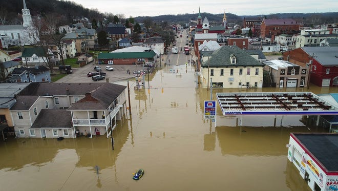 The Ohio River floods downtown Aurora, Ind., on Feb. 25, 2018.