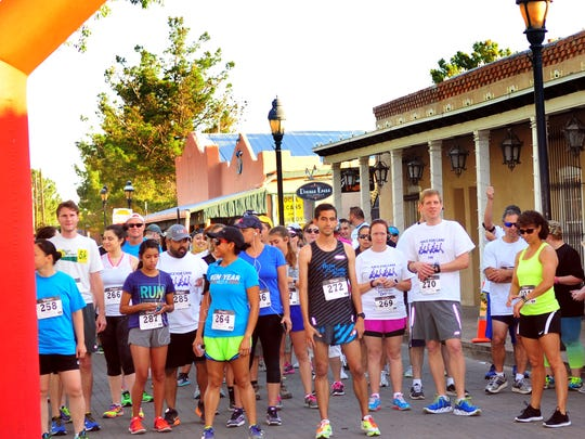 Entrants gather at the starting line before the beginning of the 5K Race for CARE on Sunday morning.  Some 200 runners took part in the event to raise money for local cancer services.