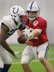Indianapolis Colts quarterback Andrew Luck (12) hands
