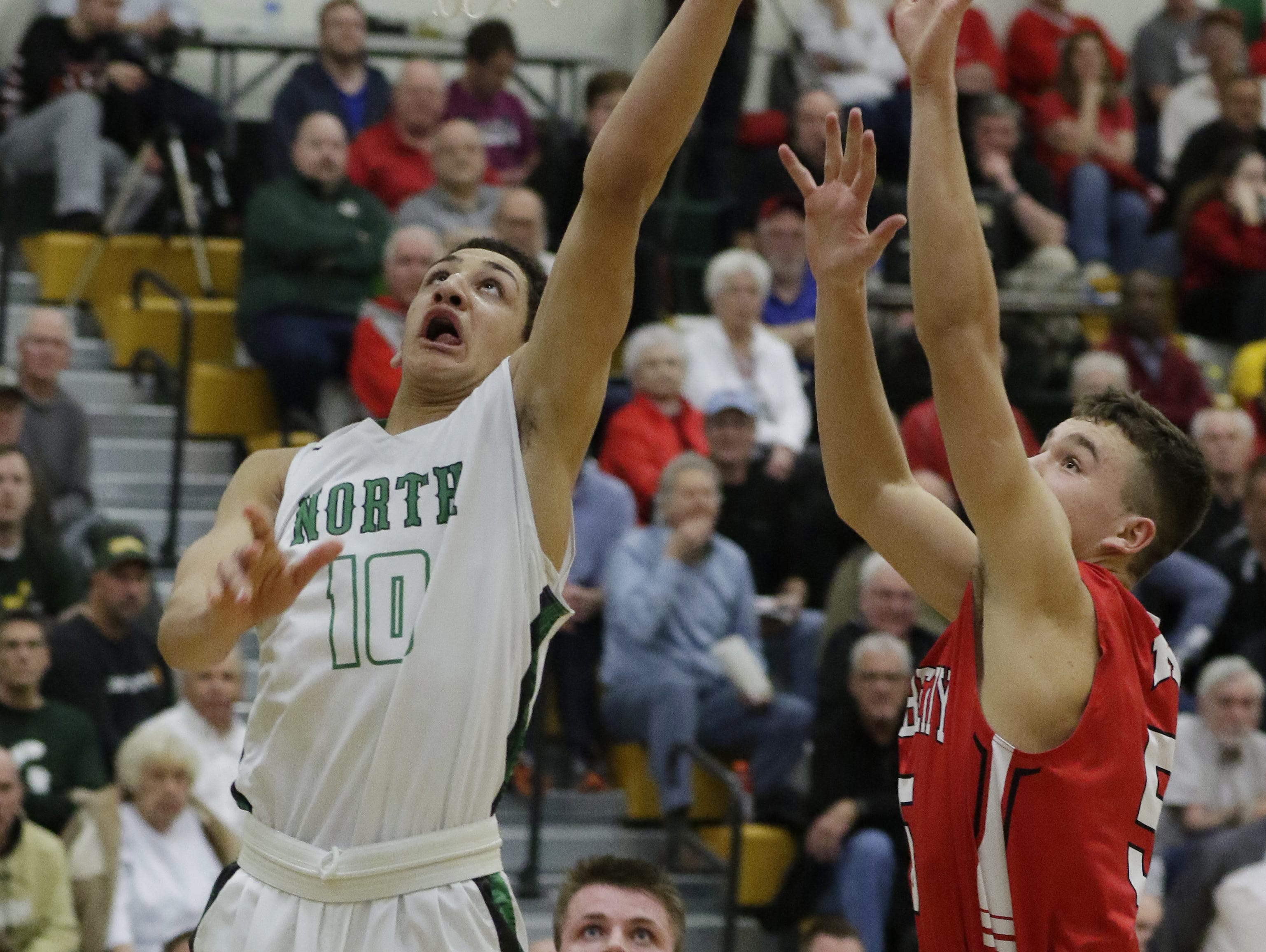 Oshkosh North's Quincy Anderson goes for a layup against Kimberly on Tuesday night.