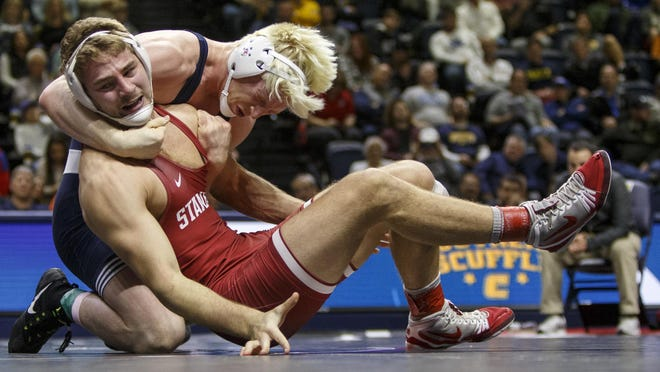 Penn State's Bo Nickal, left, wrestles with Stanford's Nathan Traxler in the 197-pound championship bout of the Southern Scuffle wrestling tournament in Chattanooga, Tenn., on Jan. 2, 2019. Wrestling is one of 11 sports that Stanford is eliminating.