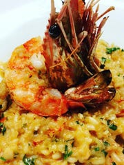 Lobster risotto with a large prawn at The Oyster Society in Marco Walk Plaza on Marco Island.