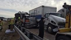 A three-semi accident caused injuries to one driver, who was pinned in his wreckage. The interstate was closed for more than an hour for cleanup.