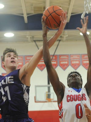 Wylie's Dylan Isenhower (21) battles Cooper's Josh Body (0) for a rebound. The Bulldogs beat Cooper 74-36 in the nondistrict game Friday, Jan. 5, 2018 at Cougar Gym.