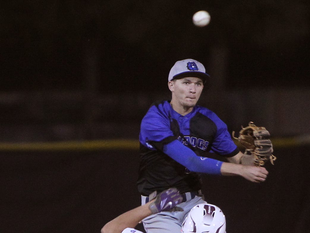 Ida Baker's Christian Proffitt throws to first after tagging the bag against Riverdale's Colton Sites Monday in East Fort Myers.