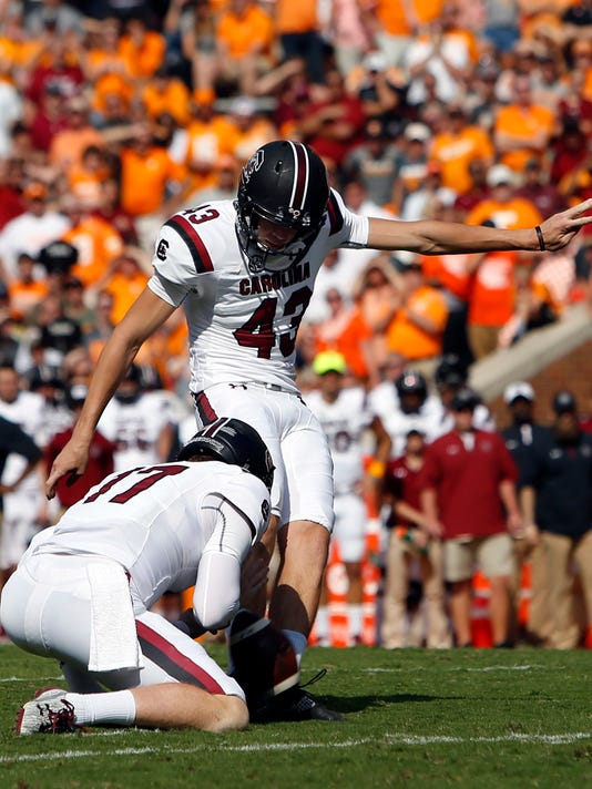 South Carolina place kicker Parker White (43) connects for a field goal as Danny Gordon (17) holds in the second half of an NCAA college football game against Tennessee, Saturday, Oct. 14, 2017, in Knoxville, Tenn. South Carolina won 15-9. (AP Photo/Wade Payne)