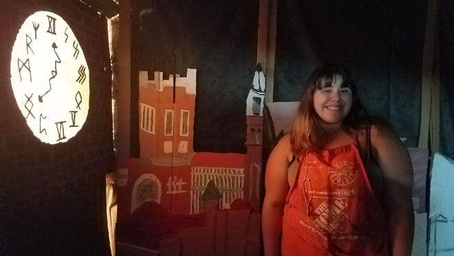 Lisa Jacenich, owner of Artful Gifts in Staunton cleared out the back room of her shop to transform the space into the magical world of Harry Potter for the Queen City Mischief and Magic festival. Intern McKenna Barry stands in front of the Staunton skyscape design she created that is now in the back room. The project helped her get accepted into the University of Toronto for theater stage management. Jacenich hand felted the runes for numbers and crooked arms to create the magical time travel clockface.