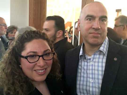 Lara Nercessian of Royal Oak, left, and Raffi Ourlian of Livonia attend a memorial Friday at St Mary's Antiochian Orthodox Church in Livonia to mark the 100th anniversary of the Armenian massacre.