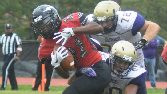 Manchester running back Shaquille Smith (21) trying