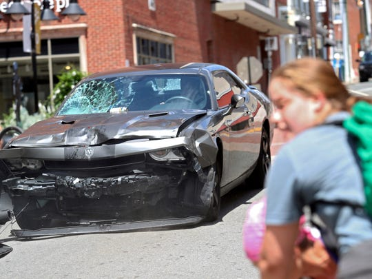 A vehicle reverses after driving into a group of protesters demonstrating against a white nationalist rally in Charlottesville, Virginia, Saturday, Aug. 12, 2017. The nationalists were holding the rally to protest plans by the city of Charlottesville to remove a statue of Confederate Gen. Robert E. Lee. There were several hundred protesters marching in a long line when the car drove into a group of them.