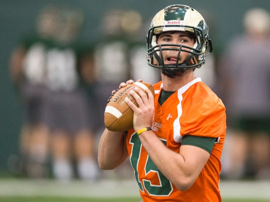 CSU quarterback Collin Hill runs a play during the first practice of the year Friday, March 25, 2016.