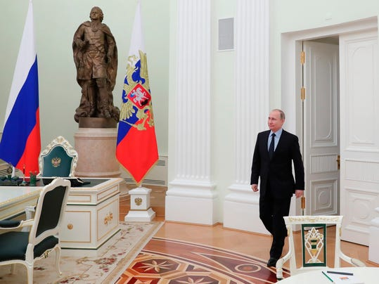 Russian President Vladimir Putin enters a hall to meet FIFA president Gianni Infantino in the Kremlin in Moscow, Russia, Monday, Feb. 12, 2018. (Mikhail Klimentyev/Pool Photo via AP)