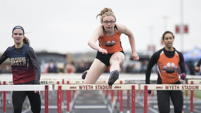 Harlem's Cloey Fare, center, clears the last hurdle before finishing first in the 110-meter hurdles during the NIC-10 girls conference meet on May 2, 2019, at Auburn.