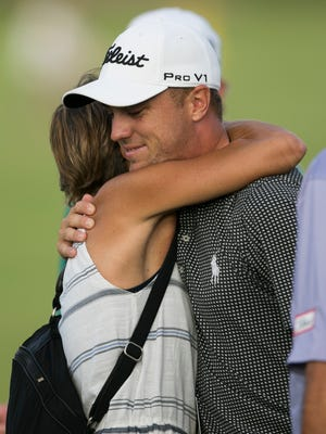 Justin Thomas, right, hugs his mother, Jani Thomas, after he won the final round of the Sony Open golf tournament, Sunday, Jan. 15, 2017, in Honolulu. (AP Photo/Marco Garcia)