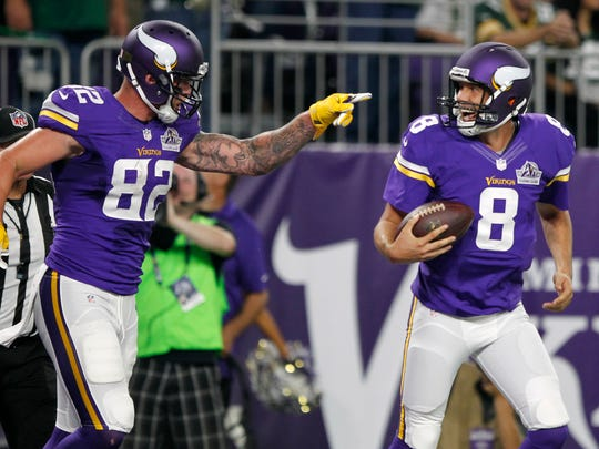 Minnesota Vikings tight end Kyle Rudolph, left, celebrates with quarterback Sam Bradford after catching an 8-yard touchdown pass during the first half of an NFL football game against the Green Bay Packers, Sunday, Sept. 18, 2016, in Minneapolis. (AP Photo/Andy Clayton-King)
