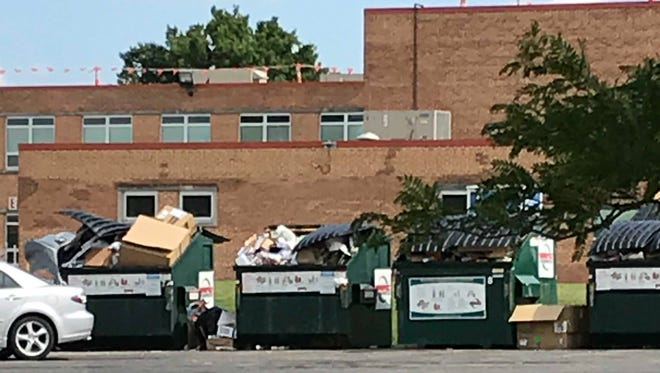 Overflowing recycling receptacles like these into which people have  dumped unwanted trash are causing problems for Fairfield Township staff. These are located near the Morris Road fire headquarters adjacent to North Elementary School.