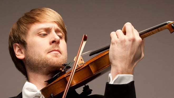 A new resident string quartet at the University of Indianapolis includes violinists Zach De Pue (pictured) and Austin Hartman, cellist Austin Huntington and violist Michael Strauss.