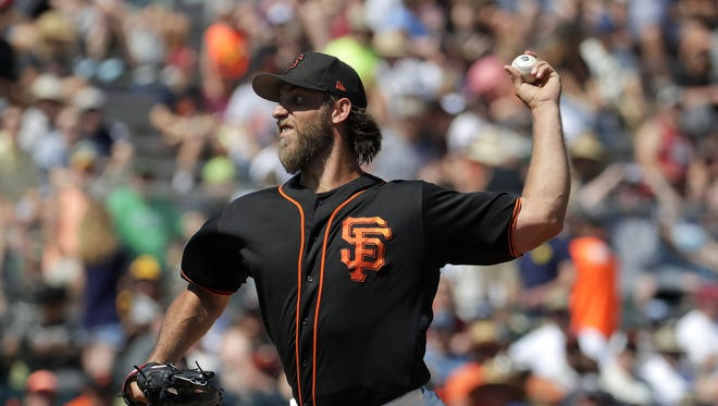 San Francisco Giants starting pitcher Madison Bumgarner throws against the San Diego Padres during the second inning of a spring training baseball game, Tuesday, March 21, 2017, in Scottsdale, Ariz.
