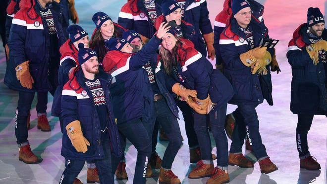 Athletes from the United States take a selfie during the opening ceremony for the Pyeongchang 2018 Olympic Winter Games at Pyeongchang Olympic Stadium on Feb. 9.