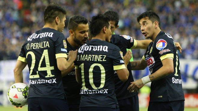 Club America forward Raul Jimenez (9) celebrates his goal against Montreal Impact with teammates during the second half at Olympic Stadium.