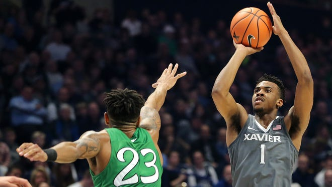 Xavier Musketeers guard Paul Scruggs (1) rises for a shot in the second half during the college basketball game between the Marshall Thundering Herd and the Xavier Musketeers, Tuesday, Dec. 19, 2017, at Cintas Center in Cincinnati.
