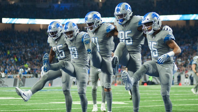 Detroit Lions wide receiver T.J. Jones (13) celebrates his touchdown with running back Theo Riddick (25) wide receiver Marvin Jones (11) tight end Eric Ebron (85) and wide receiver Golden Tate (15) during the second quarter against the Chicago Bears at Ford Field.