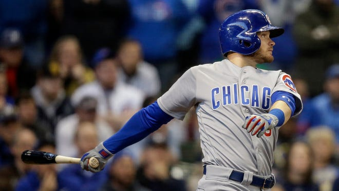 Ian Happ watches his two-RBI single off of Milwaukee Brewers' Jacob Barnes in the ninth inning.